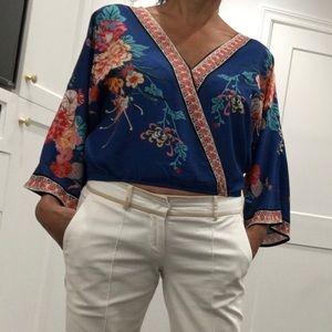 Beautiful blue blouse with flower print.